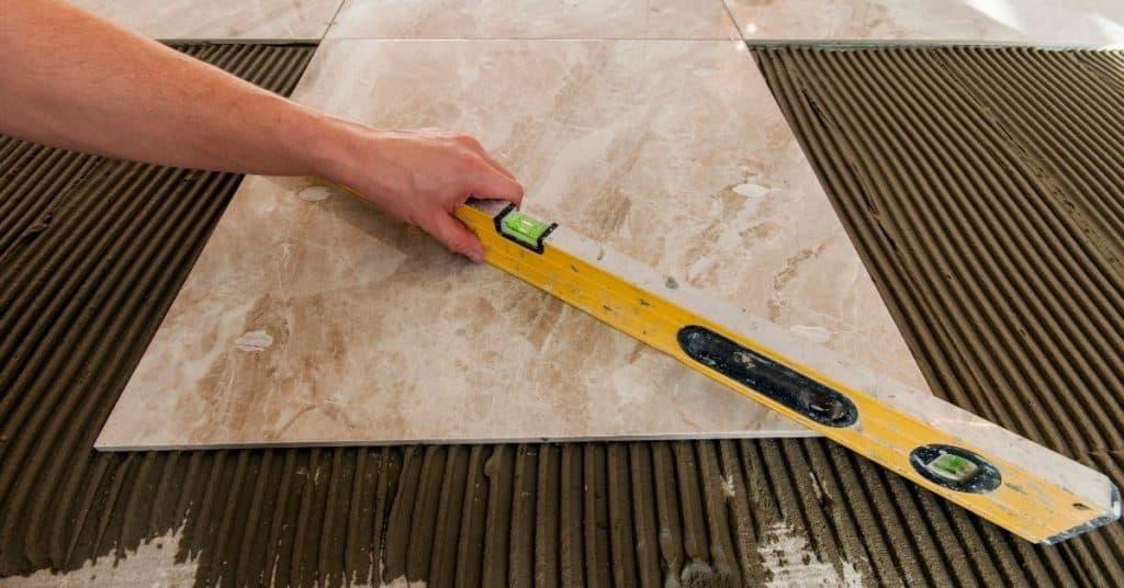 Instalation laminate floors vs tile floors